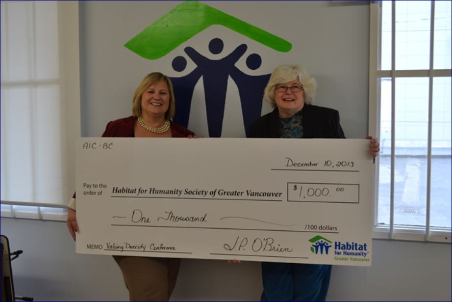 CAE Executive Director Janice O'Brien donating a $1000 cheque to Habitat For Humanity Of Greater Vancouver